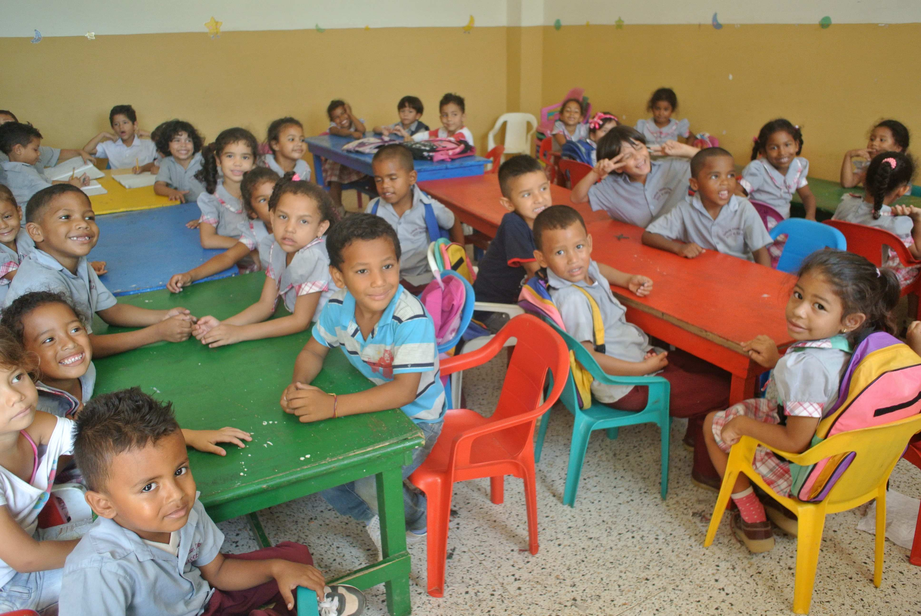 A classroom of smiling school children in Columbia.